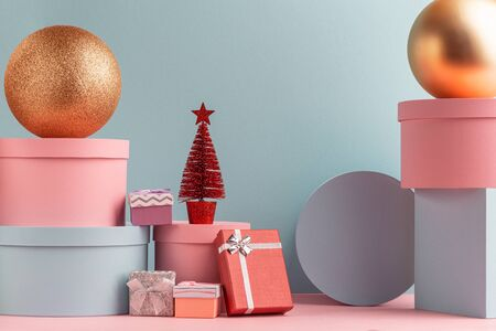 Lot of various gift boxes, balls and Christmas tree on teal background