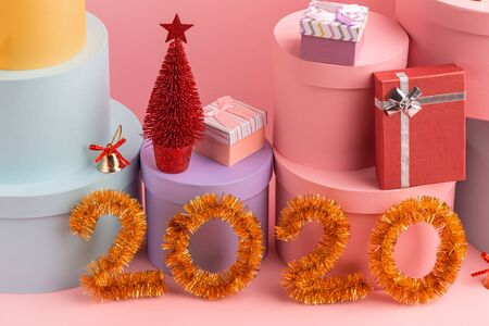 Happy New Year 2020 greeting card on pink background