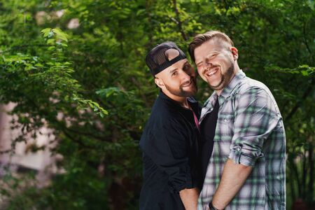 Portrait of a gay couple with a tree in the background 写真素材