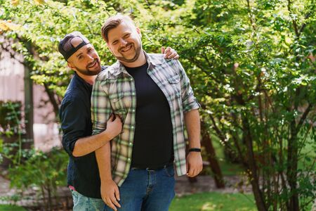 Portrait of beautiful gay couple in the park