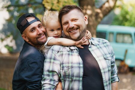 Portrait of gay family in the yard