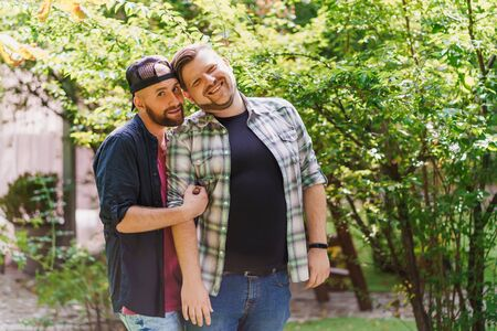 Portrait of lovely gay couple in the park