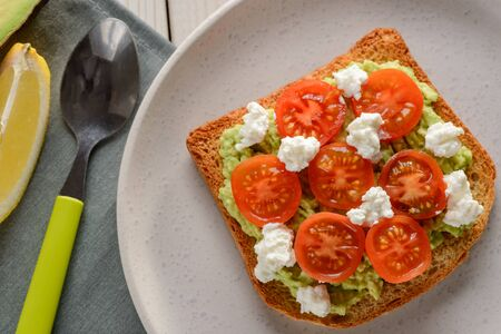 Toast with tomato, ricotta and avocado. Yummy snack