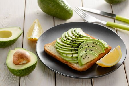 Toast with avocado slices. Healthy snacks for breakfast Reklamní fotografie