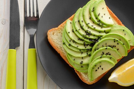 Avocado toast with sesame seeds and lemon