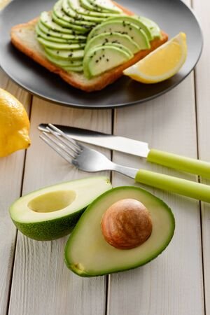 Avocado halves and toast with slices. Snack and healthy nutrition Reklamní fotografie