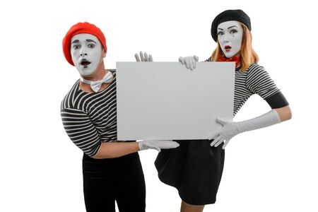 Mime actors holding white placard. Blank space to insert your text or picture