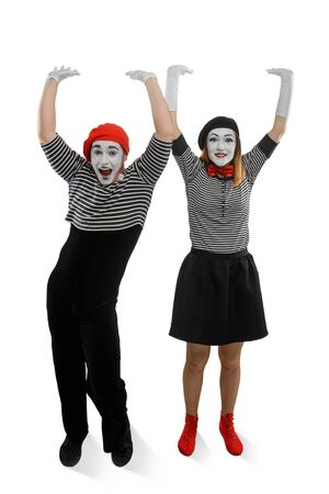 Smiling mimes holding something heavy. Illusions and funny acting