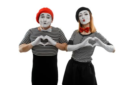 Mimes making a heart shape with their hands