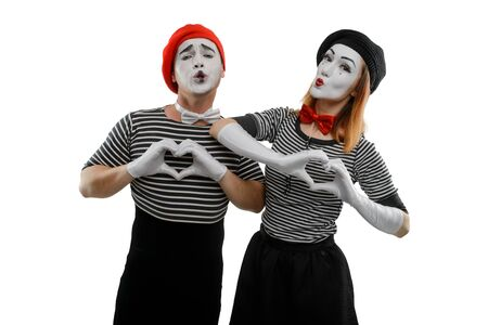 Love scene of pantomime actors. Male and female mime artists