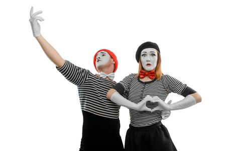 Mime couple in love. Surprised face of woman and man embracing her waist