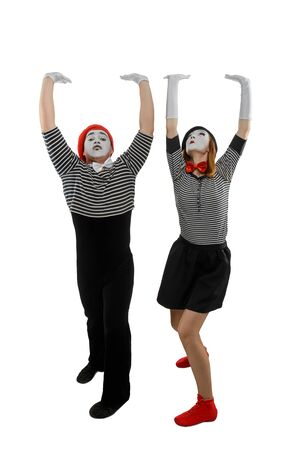 Couple of mimes in action. Man and woman performing a pantomime