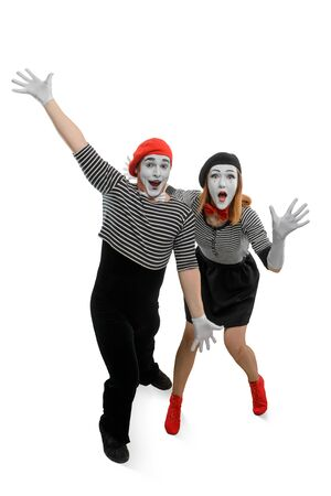 Two mimes are having fun. Vertical full length portrait of man and woman