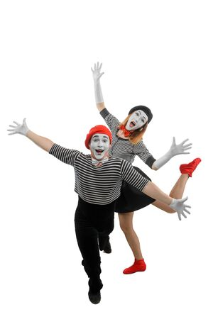 Male and female mimes dancing with wide open arms