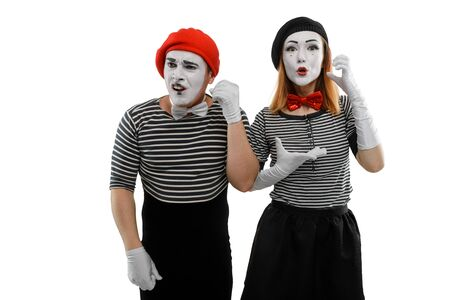 Mime couple isolated on white. Man and woman playing a pantomime