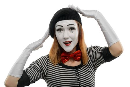 Woman tries on new hat. A pantomime sketch, performed by a female mime artist