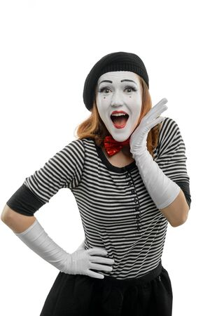 Happy female mime on white background. Vertical portrait of actress