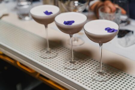 Beautiful coffee cocktails decorated with violet flower petals