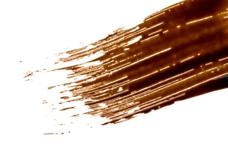 Stroke of melted chocolate on white background