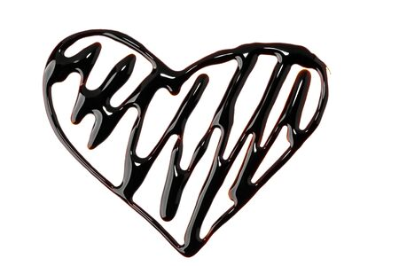 Heart shape painted with chocolate syrup with zig zag pattern Stock fotó