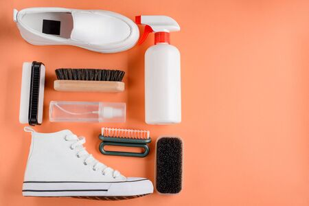 Cleaning products for shoes on orange background