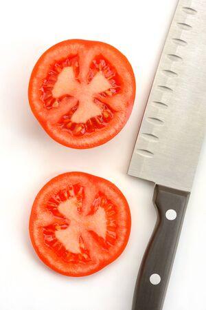 Tomato slices and a santoku knife on white background Stock fotó - 142420207