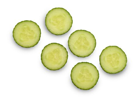 Cucumber circle slices on white background, top view
