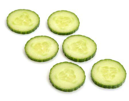 Fresh cucumber circle slices on white background