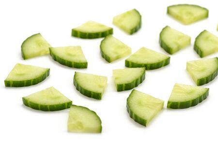 Cucumber quarter slices on white background