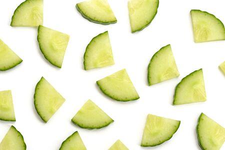 Cucumber quarter slices on white background.