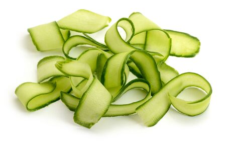 Fresh cucumber ribbon peels on white background