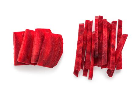 Beetroot slices and sticks on white background, top view. Heaps of freshly cut red vegetable.