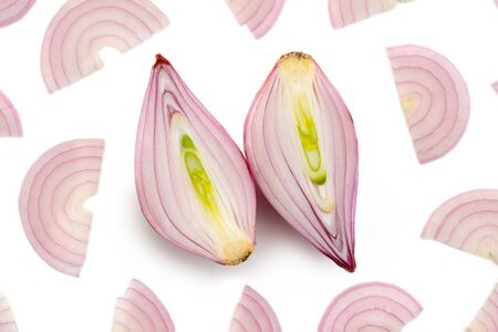 Halved shallot and red onion half moon slices on white