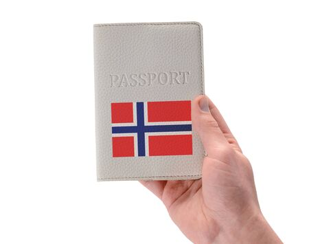 Norwegian passport in a mans hand on white background