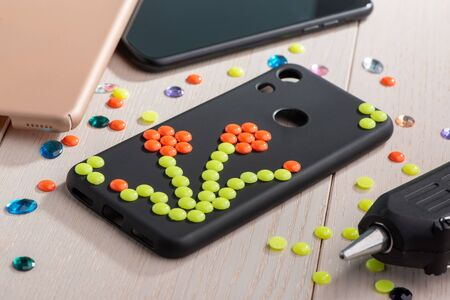 Black phone case decorated with flower bead art