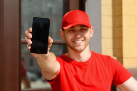 Man is showing a phone, selective focus