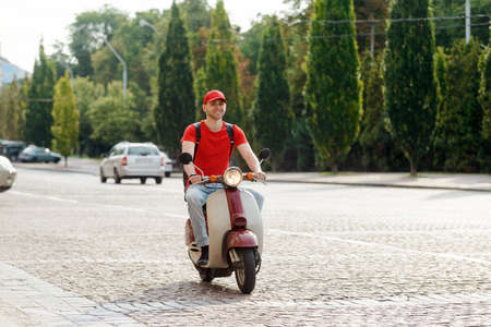 Handsome guy is riding on a motorbike Imagens