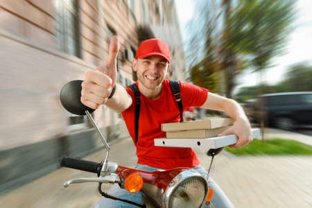 Deliveryman is showing thumb up gesture. Quality service, pizza delivery concept