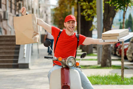 Happy worker showing food package with wide apart arms