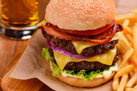 Enormous double cheeseburger. Classic of fast food industry