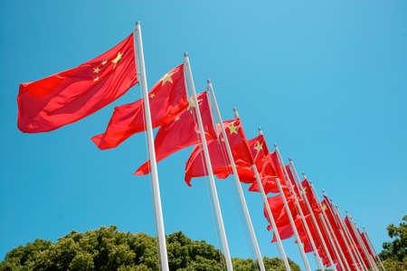 National flag of China fluttering on blue sky Banque d'images