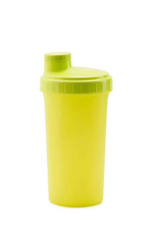 Yellow plastic shaker isolated on white background
