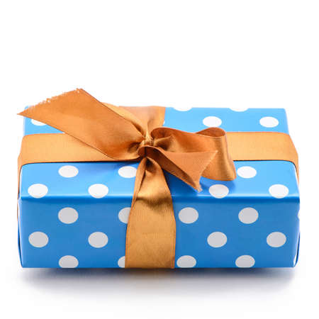 Blue gift box with bronze satin ribbon on white background