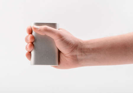 Hand holding a power bank, isolated on white