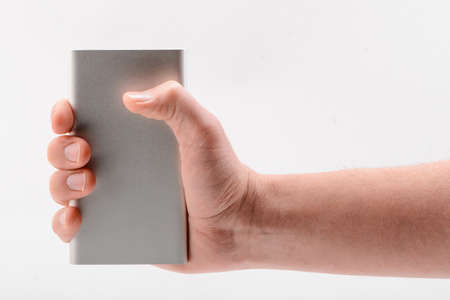 Hand holding a power bank on white background Archivio Fotografico