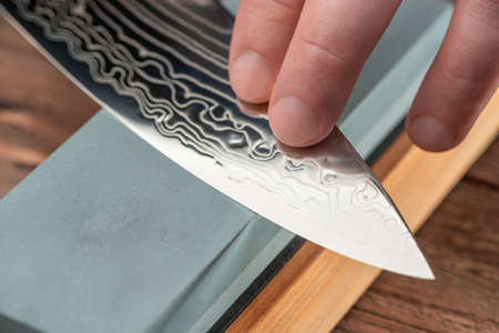 Close-up on a blade made of Damascus steel 免版税图像
