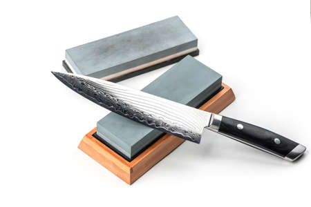 Japanese chefs knife and whetstones isolated on white backgroun 免版税图像