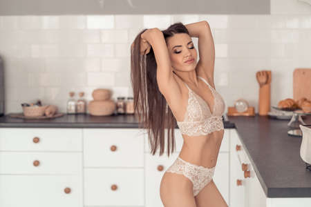 Beautiful pic of a young woman dressed in white lingerie