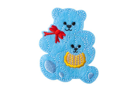 Blue mama bear and cub embroidered patch isolated on white background 免版税图像
