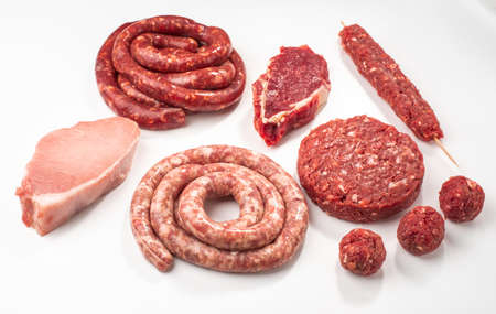Top view on variety of semi-finished meat products on white back